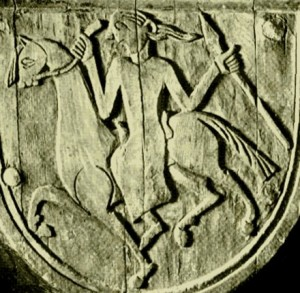 Ridende kvinne med spyd på en av pilarene i Urnes stavkirke.