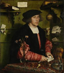 Den hanseatiske kjøpmannen Georg Gisze. Legg merke til stempelet han har på bordet: Deler av et tilsvarende stempel er funnet på Avaldsnes. (Maleri av Hans Holbein).